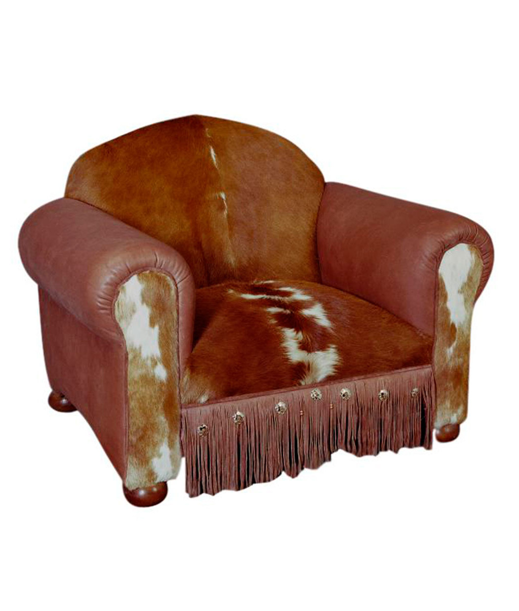 Western armchair with cowhide, full grain leather, fringe and conchos from Rustic Artistry