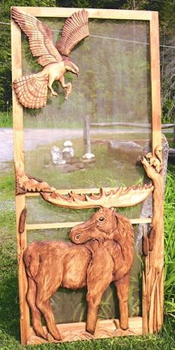 cabin screen door with caving moose and eagle