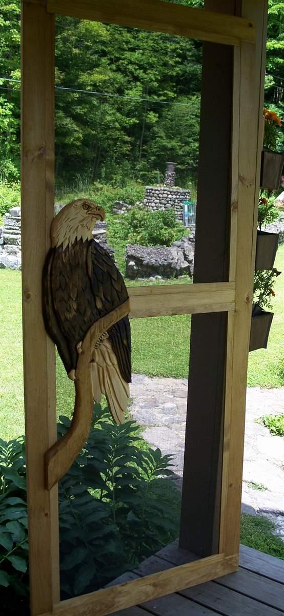 carved wooden door eagle