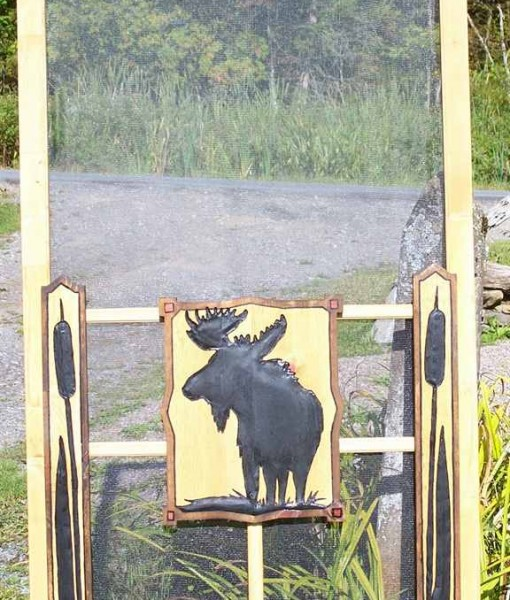wooden screen door with carving moose