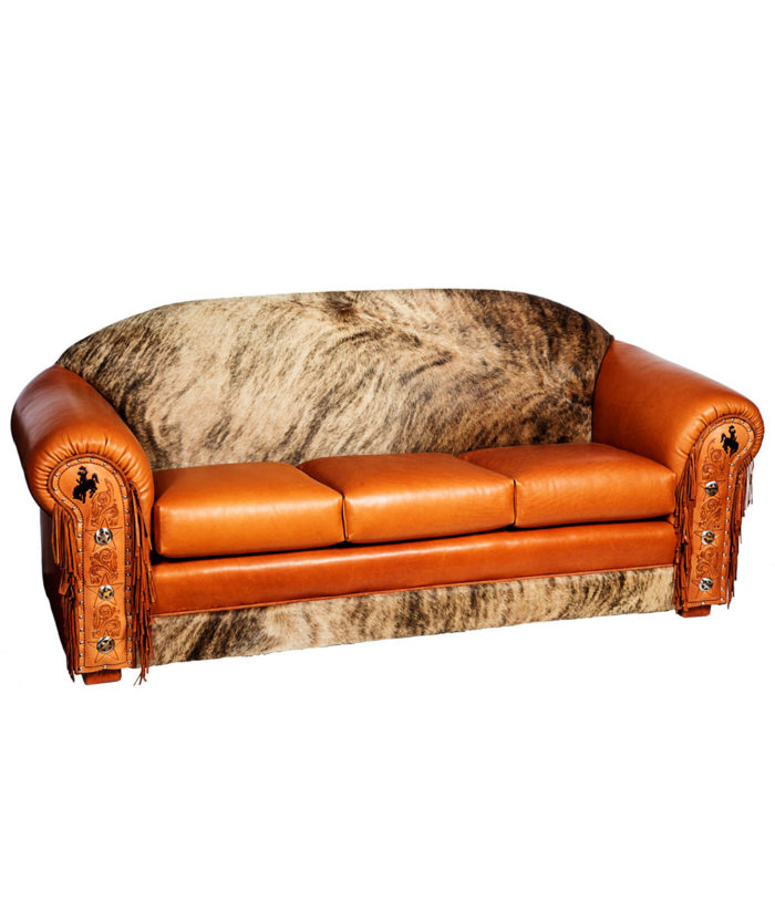 Cowhide and leather sofa with tooled leather, fringe and conchos, Fully customizable | Western furniture and decor from RusticArtistry.com