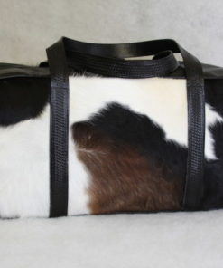 Black brown and white cowhide duffel bag