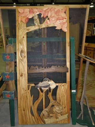 carved wood screen door with beaver, duck, owl and tree by the lake