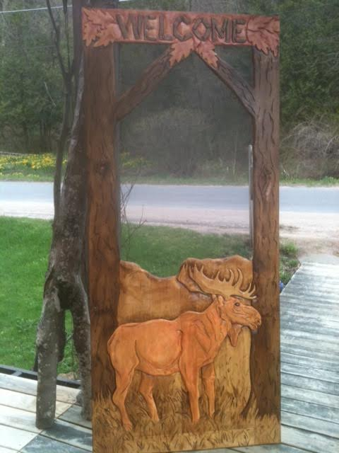 carved wood screen door with full covered bottom, moose, trees