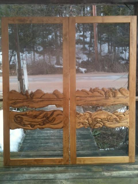 double wood screen doors with hand carved fishing scene