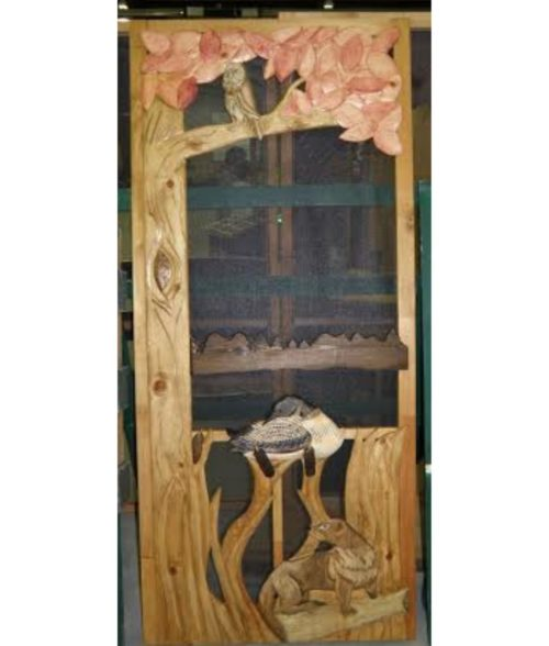 otter, loon and owl in tree carved wood screen door