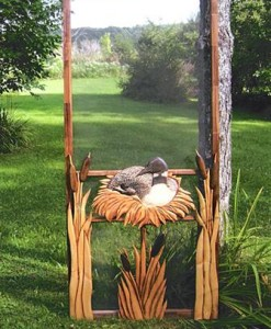 wood screen door hand carved with nesting duck and cattails