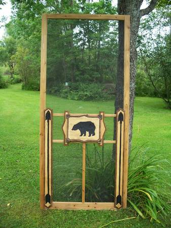 wood screen door with hand carved bear silhouette and arrows