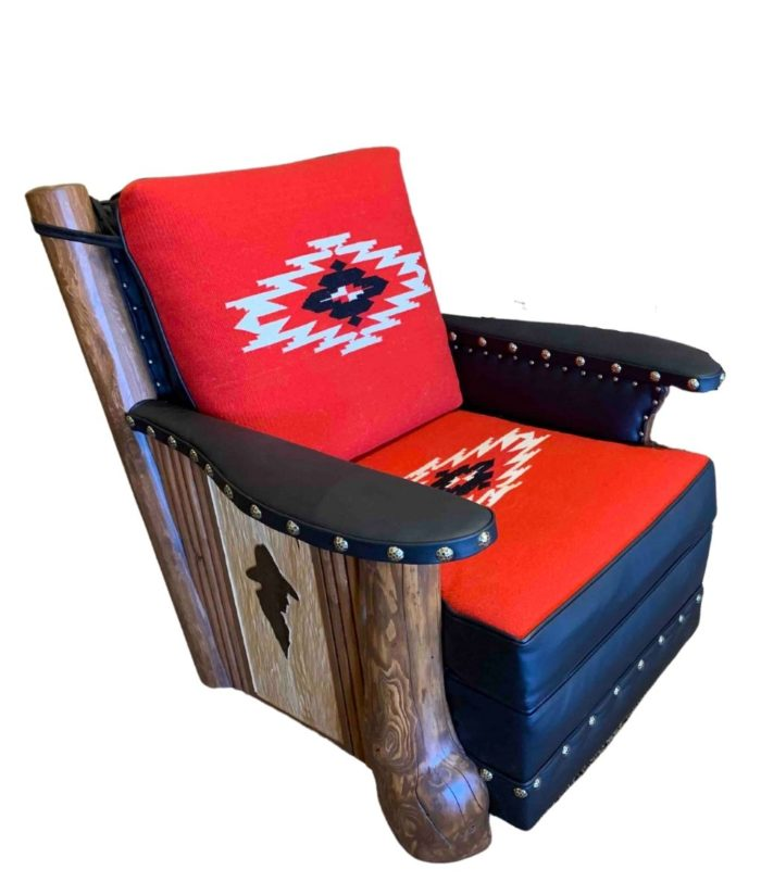 Molesworth red and black club chair with cowboy profile carving